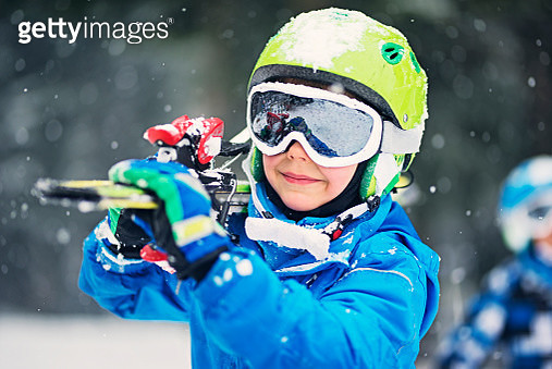 Portrait of little skier with skis - gettyimageskorea
