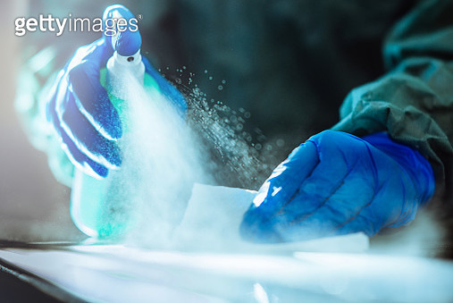 Spraying disinfection on surface. - gettyimageskorea