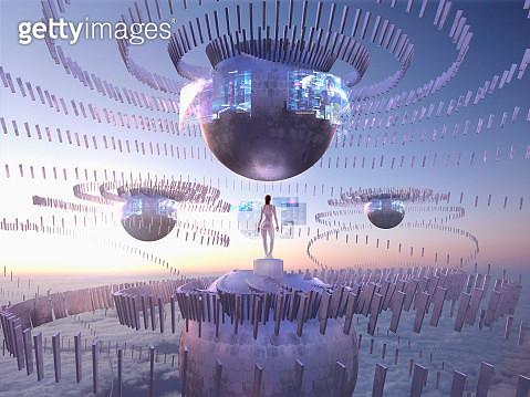 Futuristic Pacific Islander woman on sphere in sky watching holograms - gettyimageskorea