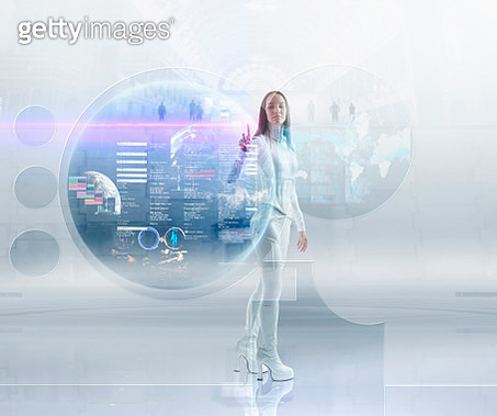 Futuristic Pacific Islander woman touching floating hologram - gettyimageskorea