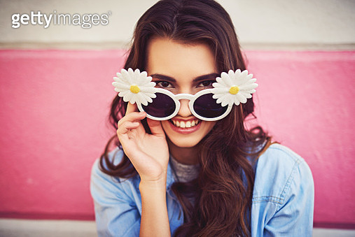 Cropped shot of a beautiful young woman wearing novelty sunglasses and posing against a wall outside - gettyimageskorea