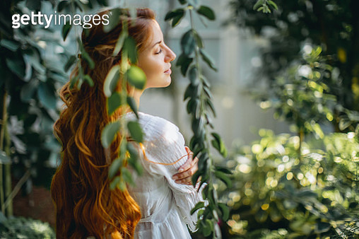 Dreamy woman in tropical environment - gettyimageskorea