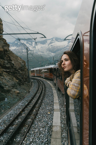 Woman looking out of the window on the train near Matterhorn - gettyimageskorea