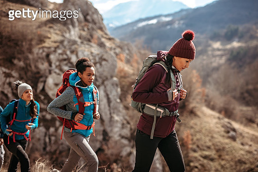 Group of tourist on hiking tour walking in nature - gettyimageskorea