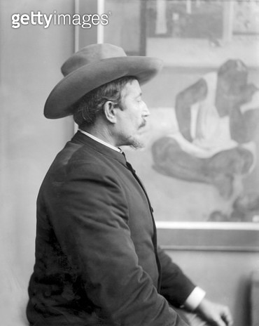 <b>Title</b> : Paul Gauguin (1848-1903) in front of his canvases (b/w photo)<br><b>Medium</b> : photograph<br><b>Location</b> : Private Collection<br> - gettyimageskorea