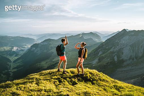 Trail runners ascend high mountain ridge - gettyimageskorea