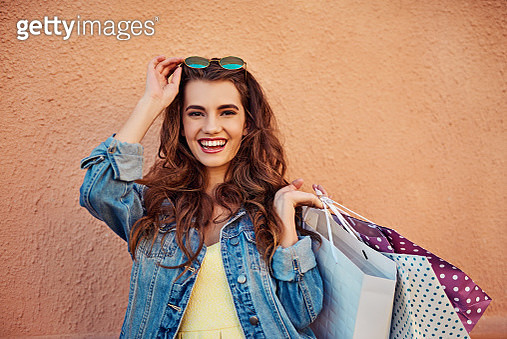 Cropped shot of a beautiful young woman on a shopping spree in the city - gettyimageskorea