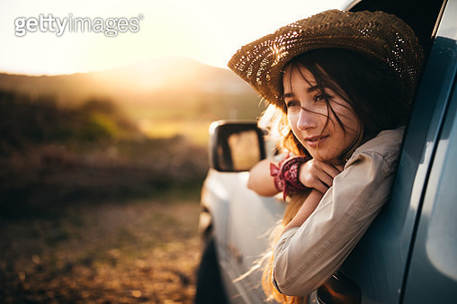 Young woman sitting in a pick-up truck in the country - gettyimageskorea