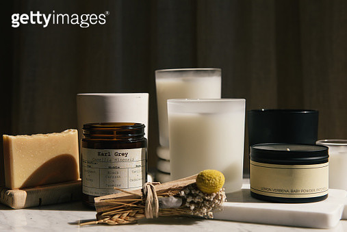 Side view of home beauty products of candles, soap and palo santo - gettyimageskorea