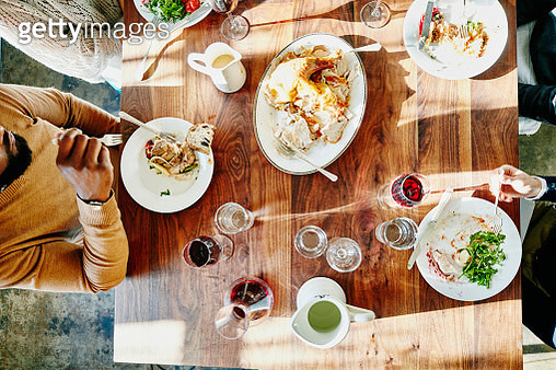 Overhead view of friends sharing holiday meal - gettyimageskorea