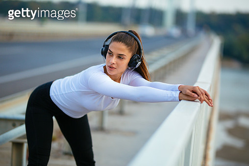 Photo of woman athlete warming up for morning workout - gettyimageskorea