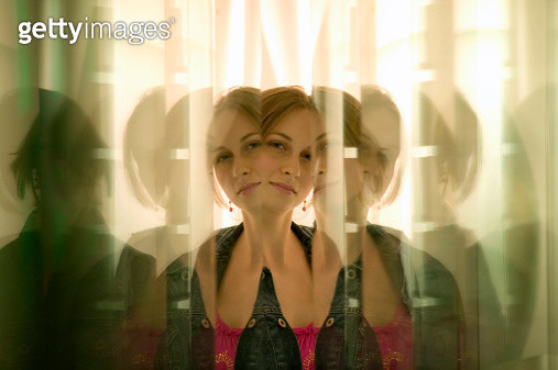 Teenage girl (16-17) reflecting in glass panes - gettyimageskorea