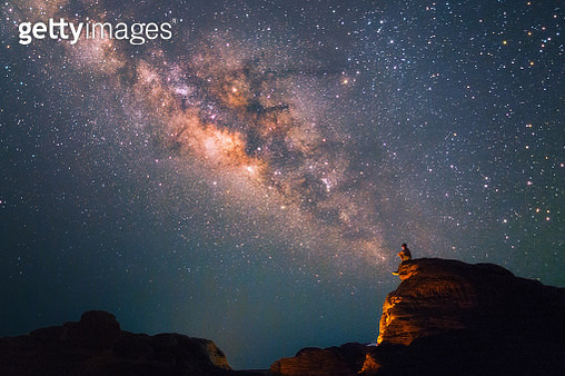 Silhouette man sits on the top of rock looking at the beautiful Milky Way Stars at the Grand Canyon of Thailand (Sam Phan Bok) - gettyimageskorea