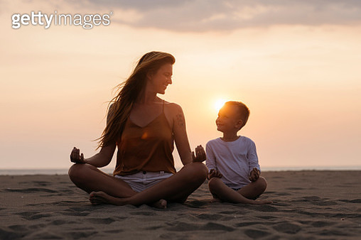 Mom and son doing yoga - gettyimageskorea