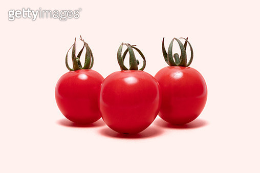 Red Cherry Tomato on Soild Pastle Red Colored Background, Clipping Path. - gettyimageskorea