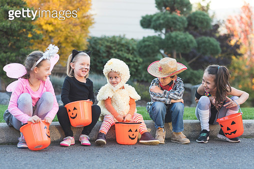 Multiethnic group of kids trick or treating - gettyimageskorea