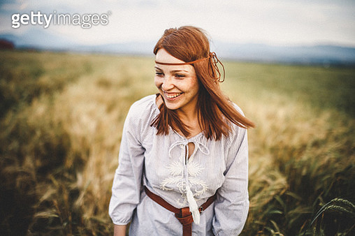 Portrait of confident young woman in nature - gettyimageskorea