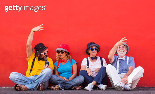 Fashionable People Sitting Against Wall - gettyimageskorea
