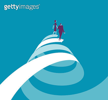 Businesswoman and businessman walking on two spiral arrows - gettyimageskorea