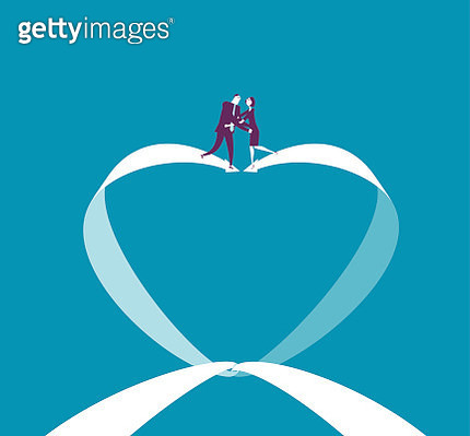 Businessman and businesswoman meet on the arrow of heart sign - gettyimageskorea