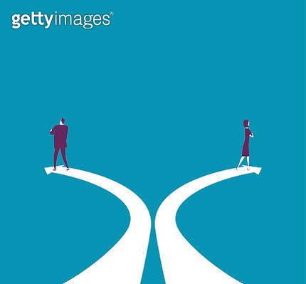 Businessman and businesswoman walking counter direction - gettyimageskorea