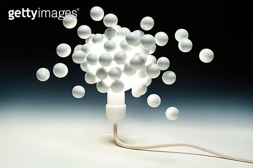 Many white eggs diffusion from the gathered around light bulbe. - gettyimageskorea