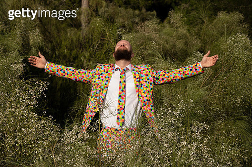Bearded man wearing suit with colourful polka-dots enjoying nature - gettyimageskorea