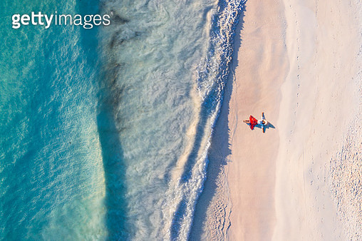 Aerial view of woman standing on the shoreline, Tulum Mexico - gettyimageskorea