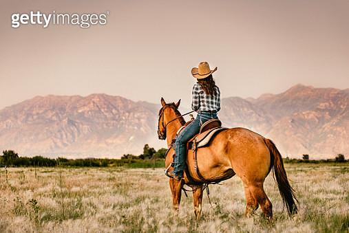 Cowgirl Horseback Riding - gettyimageskorea