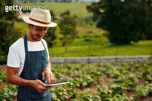 Cropped shot of a handsome young man using a tablet while working on his farm - gettyimageskorea