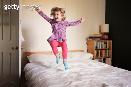 Dancing on the bed - gettyimageskorea