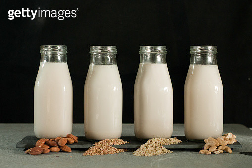 Various Types Of Milk Bottles Against Black Background - gettyimageskorea