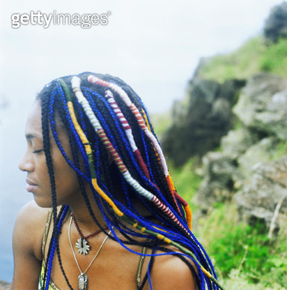 Profile of woman with colorful braids - gettyimageskorea