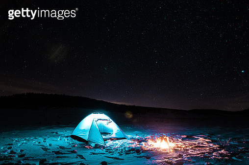 Camping at night in the cold - gettyimageskorea