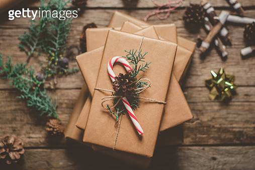 Christmas gifts on wooden table - gettyimageskorea