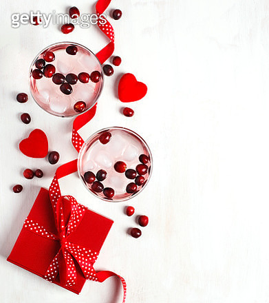 Red cranberry cocktail with vodka and red gift box on white backgroun - gettyimageskorea