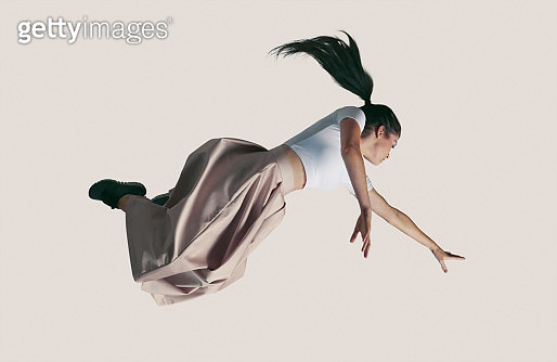 People captured in mid air, while jumping on trampoline in big studio. - gettyimageskorea