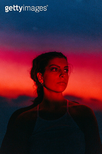 Photo of a teenage girl illuminated with neon lights - gettyimageskorea