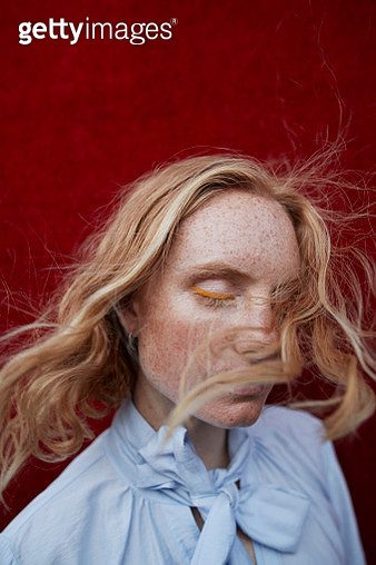 Beautiful woman with freckles standing outdoors - gettyimageskorea