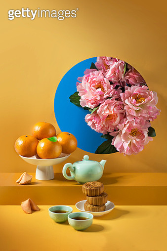 A pile of tangerine, snacks and tea served on vibrant coloured background. Text space image. - gettyimageskorea