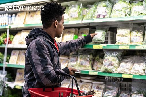 Customer Buying Greens on Supermarket - gettyimageskorea