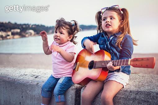 Little children have fun on sunset tropical beach - gettyimageskorea