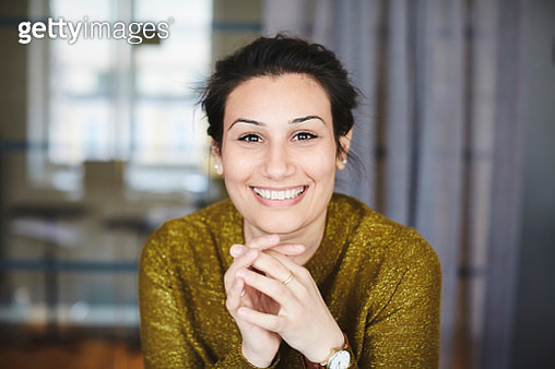 Portrait of smiling businesswoman at creative office - gettyimageskorea