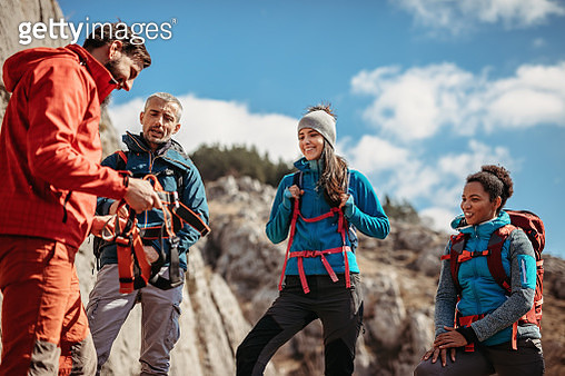 Group of tourist with climbing instructor preparing for an outdoor rock climbing - gettyimageskorea