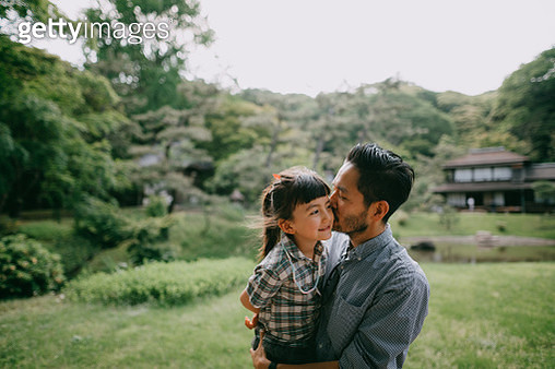 Japanese father kissing preschool mixed race daughter - gettyimageskorea