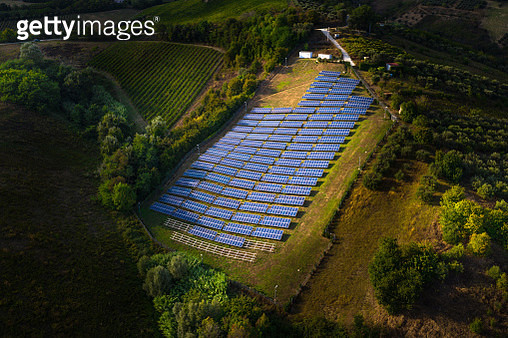 Solar panels fields on the green hills in Italy - gettyimageskorea