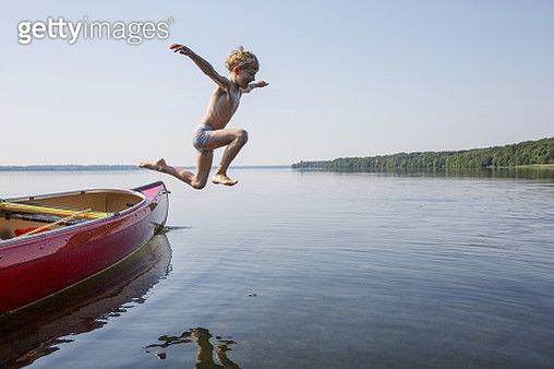 A young boy playing in the summer on Esrum Lake in Denmark. - gettyimageskorea