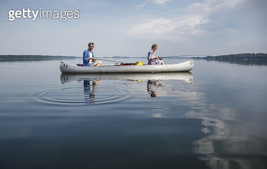 A young couple fishing on a summer day on Esrum Lake in Denmark. - gettyimageskorea
