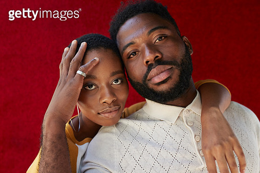 Close-up portrait of friends against red wall - gettyimageskorea