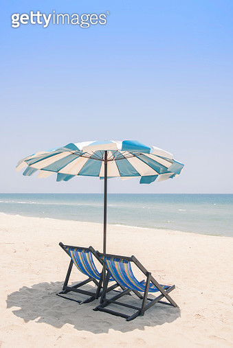 Deck Chairs On Beach Against Clear Sky - gettyimageskorea
